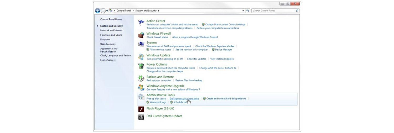 Windows 7のシステムとセキュリティ ポップアップウィンドウで、手のポインターが「ハードドライブの最適化」リンクの上に重なります